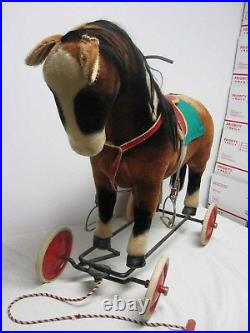 VINTAGE STEIFF RIDE ON MOHAIR HORSE with WHEELS, STEERING BAR & WHINNIES
